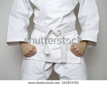 standing fighter white belt centered martial arts white suit - stock photo