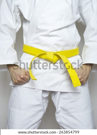standing fighter yellow belt martial arts white suit - stock photo