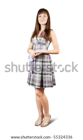 Standing girl in  checked  dress. Isolated with clipping path - stock photo