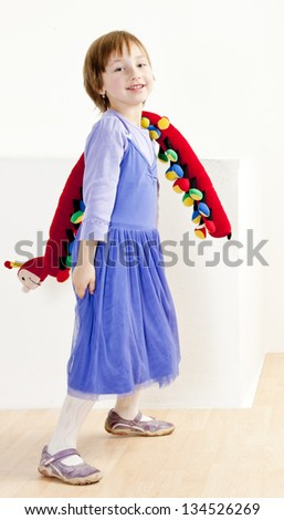 standing girl with a toy - stock photo