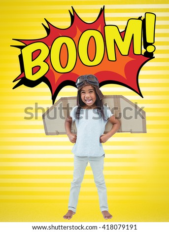 Standing girl with fake wings pretending to be pilot against yellow background - stock photo