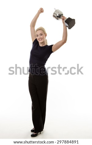 standing happy business woman holding a large trophy  - stock photo