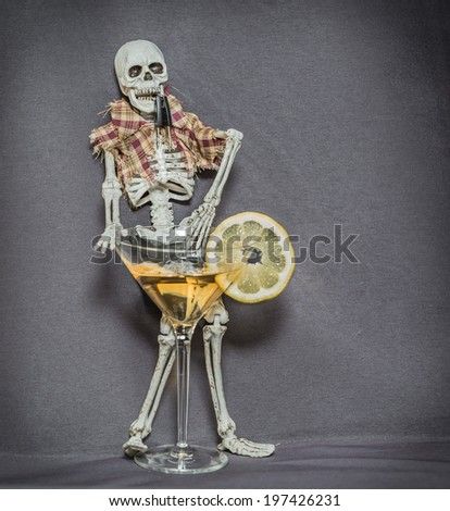happy skeleton sitting behind table dark stock photo 424063906, Skeleton