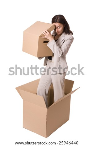 standing in cardboard box businesswoman  looks to box - stock photo