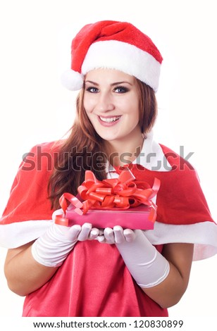 Standing indoors and holding christmas gift - stock photo