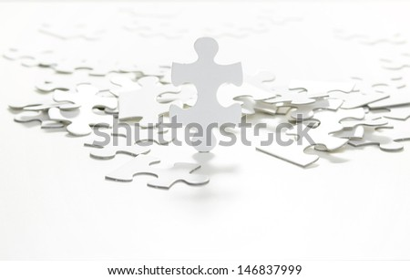 Standing jigsaw puzzle - stock photo