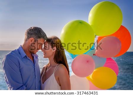 standing love couple on blue sea - stock photo