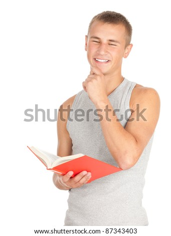 standing male student in casual shirt reading book, white background