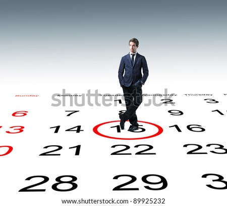 standing man and 3d calendar background - stock photo