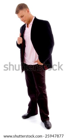 standing man looking downward on an isolated background - stock photo