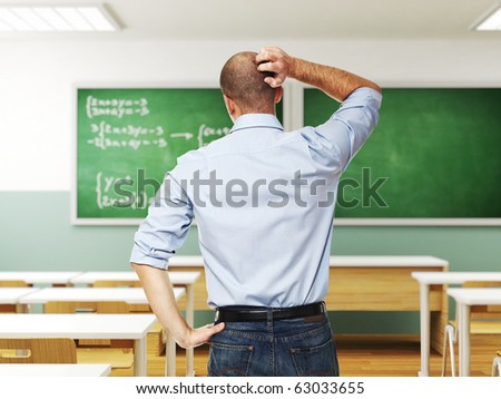 standing man thinking infront of blackboard - stock photo