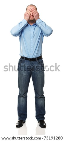 standing man with hands on his eyes