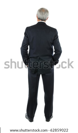 Standing middle aged businessman with both hands in his pockets. Business man is in full  length shot of the mans back over a white background. - stock photo