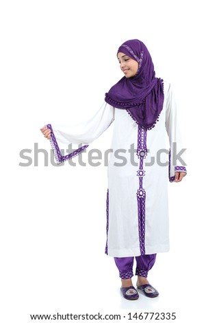 Standing muslim woman posing wearing a hijab isolated on a white background              - stock photo