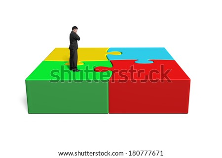 Standing on 3d puzzles isolated in white background - stock photo