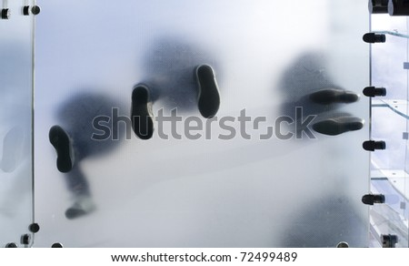Standing on glass from bottom - stock photo