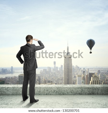 standing on roof and balloon - stock photo