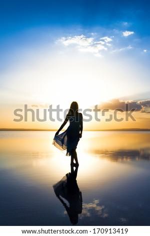 Standing on Salt Lake at sunset - stock photo