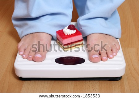 Standing on scale - stock photo