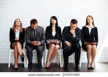 Standing out from crowd, confident business woman waiting for job interview - stock photo