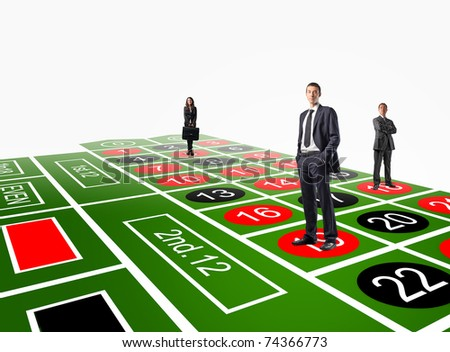 standing people on 3d roulette table - stock photo