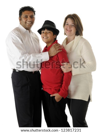 Standing portrait of a happy biracial family of three -- an Asian Indian dad, caucasian mom and their preteen son.  On a white background. - stock photo