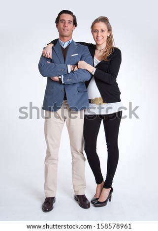 Standing portrait of a young married couple - stock photo