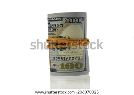 Standing roll of hundred dollars bills on white background.