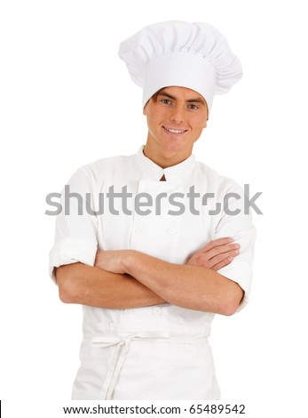 standing smiling male cook in white uniform and hat, with crossed arms - stock photo