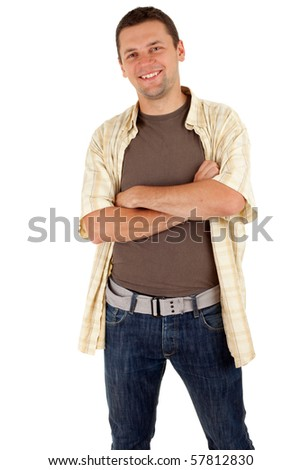 standing smiling young man with crossed arms - stock photo