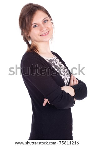 standing, smiling young woman with crossed arms - stock photo