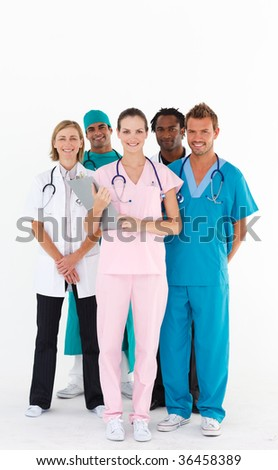 Standing team of doctors smiling at the camera - stock photo
