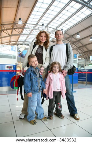standing traveling family of four - stock photo