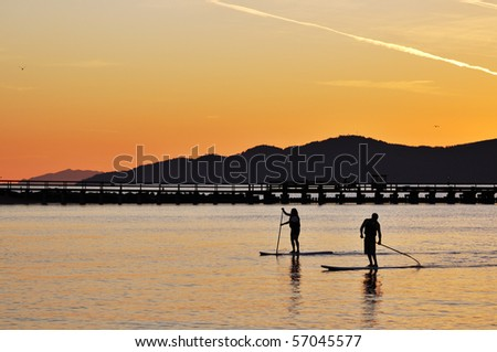Standing up paddling in English Bay, Vancouver - stock photo