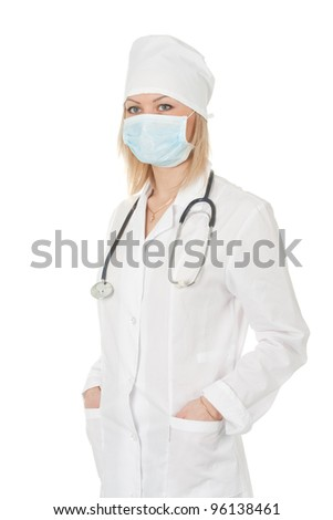 Standing woman doctor with stethoscope in a white robe