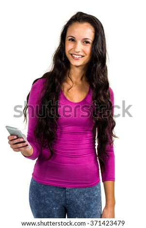 Standing woman holding smartphone and looking at the camera on white screen