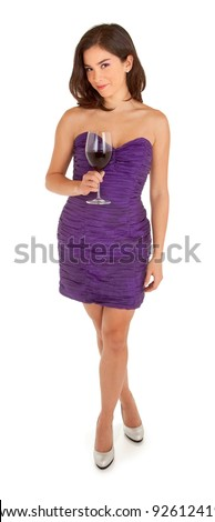 Standing Woman in an Evening Dress Holding a Glass of Wine - stock photo
