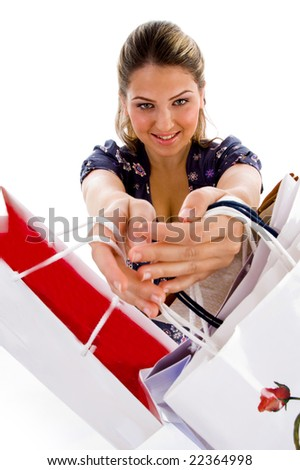 standing woman showing shopping bags with white background - stock photo