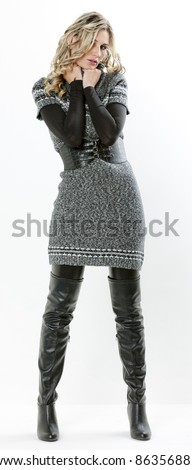 standing woman wearing dress and black boots