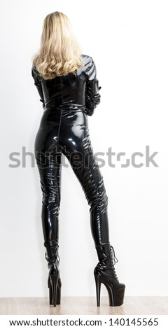 standing woman wearing extravagant clothes - stock photo