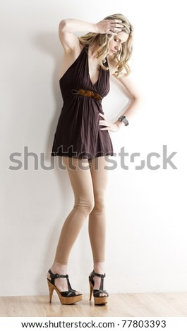 standing woman wearing summer clothes and shoes - stock photo