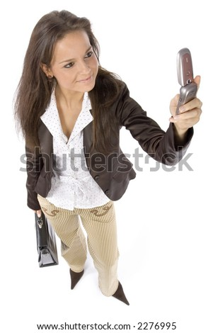 standing woman with suitcase and mobile (headshot, white background) - stock photo
