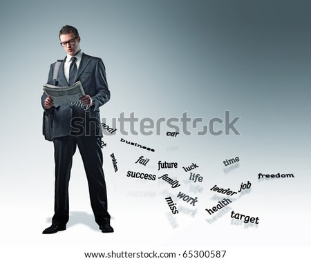 standing young businessman with newspaper and falling words - stock photo