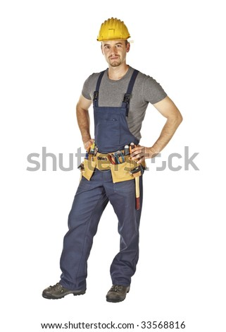 standing young caucasian manual worker on white background - stock photo