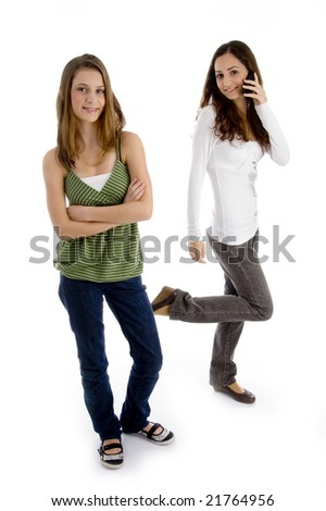 standing young friends having fun against white background - stock photo