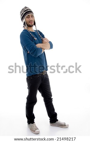 standing young male with folded hands on an isolated white background - stock photo