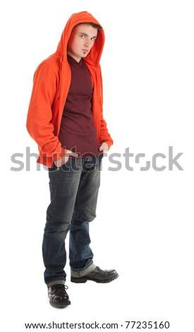 standing young man in orange sweatshirt with hood on head - stock photo
