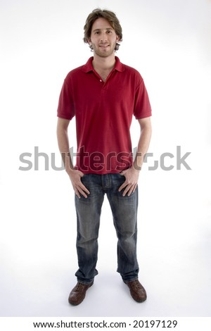 standing young man looking at you on an isolated background - stock photo