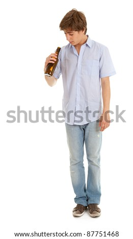 standing young man with bottle of beer, full length, white background - stock photo