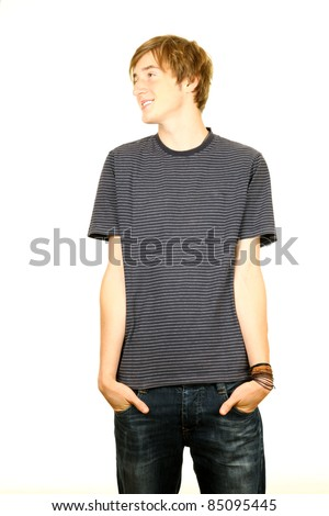 standing young man with hands in pockets looking in side - stock photo